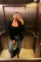 Caprice in a lift selfie