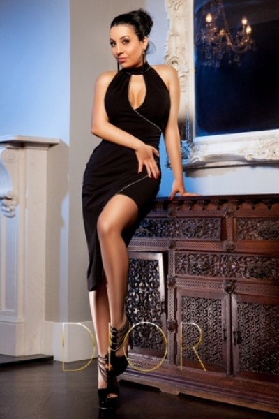 Aleeza is showing off a little leg in her black dress