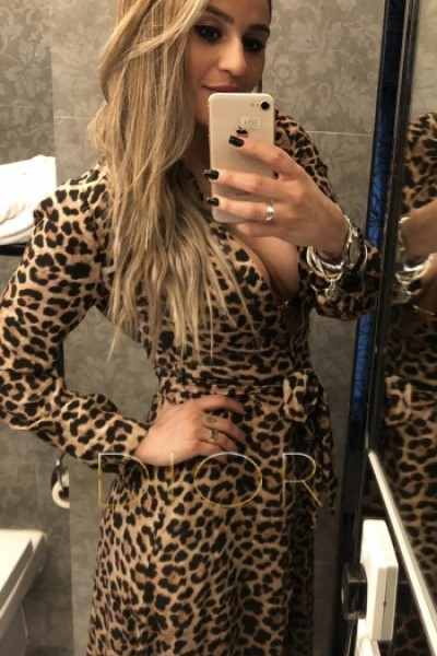 Darcied mirror selfie in lowcut leopard print dress