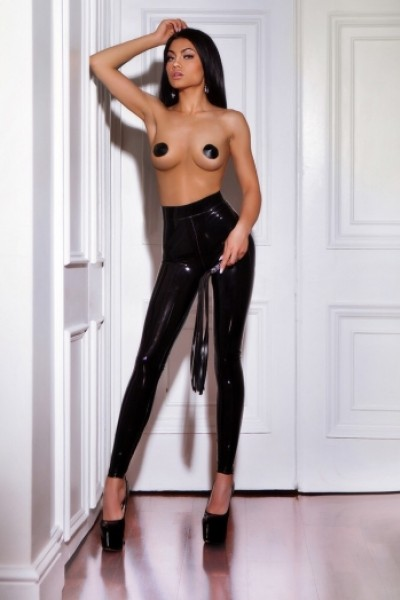 Clara posing in pvc leggings and nipple covers with whip