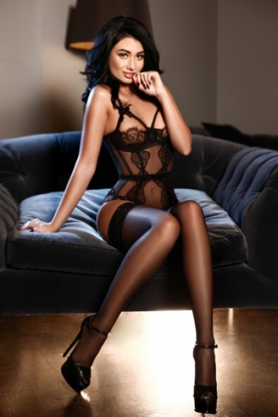 Chelsea sat in black lace boddie and stockings