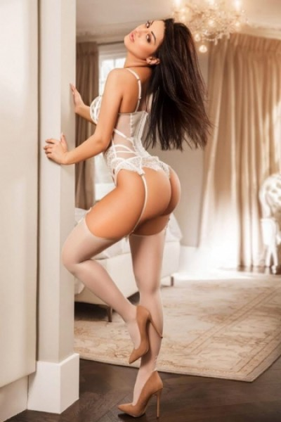 A white body, white thong, white stockings and those heels!!
