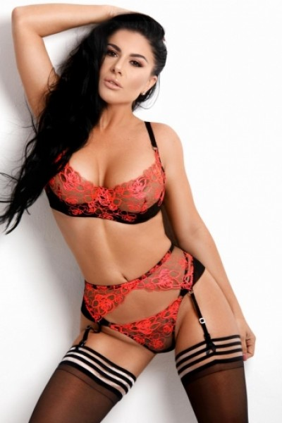 Brandy in sexy red and black lingerie and black stockings