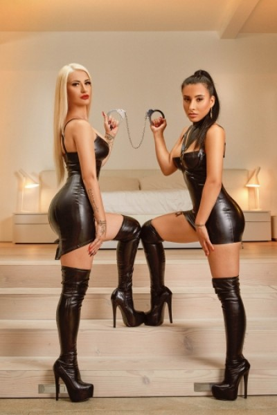 A sexy blonde and brunette in latex looking hot