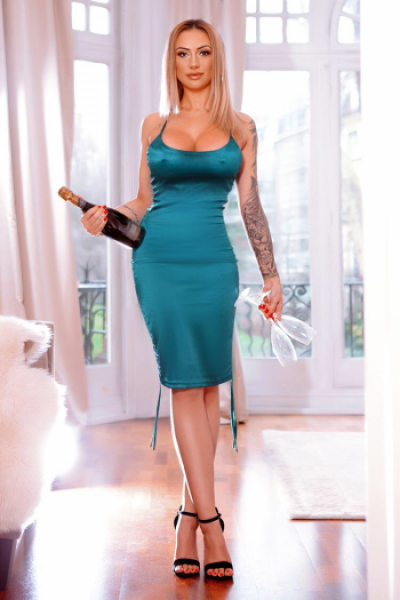 Nicky looks lovely in this green dress