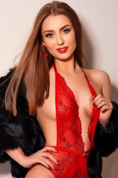 Honey wearing a red lace bodysuit